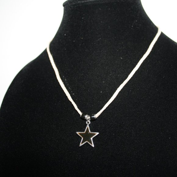 Beautiful cream necklace with mood changing star